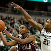 Nov 20, 2011; East Lansing, MI, USA; Arkansas Little Rock Trojans guard D'Andre Williams (10) gets past Michigan State Spartans forward Branden Dawson (22) during the second half at the Breslin Center. The Spartans won 69-47. Mandatory Credit: Tim Fuller-US PRESSWIRE