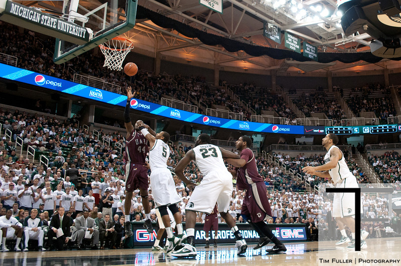 Nov 20, 2011; East Lansing, MI, USA; Arkansas Little Rock Trojans forward Michael Javes (44) puts up a shot over Michigan State Spartans center Adreian Payne (5) during the first half at the Breslin Center. The Spartans won 69-47. Mandatory Credit: Tim Fuller-US PRESSWIRE