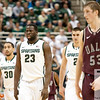 Nov 20, 2011; East Lansing, MI, USA; Michigan State Spartans guard Brandon Wood (30) and forwards Draymond Green (23) and Alex Gauna (2) along with Arkansas Little Rock Trojans forward Will Neighbour (53) during the first half at the Breslin Center. Mandatory Credit: Tim Fuller-US PRESSWIRE
