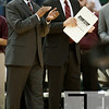 Nov 20, 2011; East Lansing, MI, USA; Arkansas Little Rock Trojans head coach Steve Shields (left) during the first half against the Michigan State Spartans at the Breslin Center. Mandatory Credit: Tim Fuller-US PRESSWIRE