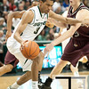 Nov 20, 2011; East Lansing, MI, USA; Michigan State Spartans guard Brandan Kearney (3) dribbles past Arkansas Little Rock Trojans forward Will Neighbour (53) during the second half at the Breslin Center. The Spartans won 69-47. Mandatory Credit: Tim Fuller-US PRESSWIRE
