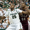 Nov 20, 2011; East Lansing, MI, USA; Michigan State Spartans center Derrick Nix (25) and Arkansas Little Rock Trojans forward Michael Javes (44) fihgt for position during the first half at the Breslin Center. Mandatory Credit: Tim Fuller-US PRESSWIRE