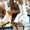 Nov 20, 2011; East Lansing, MI, USA; Arkansas Little Rock Trojans guard D'Andre Williams (10) splits through two Michigan State Spartans during the first half at the Breslin Center. Mandatory Credit: Tim Fuller-US PRESSWIRE