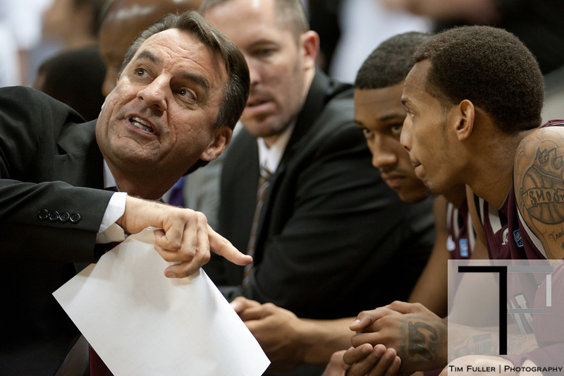 Nov 20, 2011; East Lansing, MI, USA; Arkansas Little Rock Trojans head coach Steve Shields (left) talks to his team during the second half against the Michigan State Spartans at the Breslin Center. The Spartans won 69-47. Mandatory Credit: Tim Fuller-US PRESSWIRE