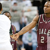 Nov 20, 2011; East Lansing, MI, USA; Arkansas Little Rock Trojans guard Tramar Sutherland (2) greets a Michigan State Spartans player before the game at the Breslin Center. Mandatory Credit: Tim Fuller-US PRESSWIRE