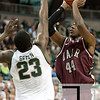Nov 20, 2011; East Lansing, MI, USA; Michigan State Spartans forward Draymond Green (23) attempts to block Arkansas Little Rock Trojans forward Michael Javes (44) during the first half at the Breslin Center. Mandatory Credit: Tim Fuller-US PRESSWIRE