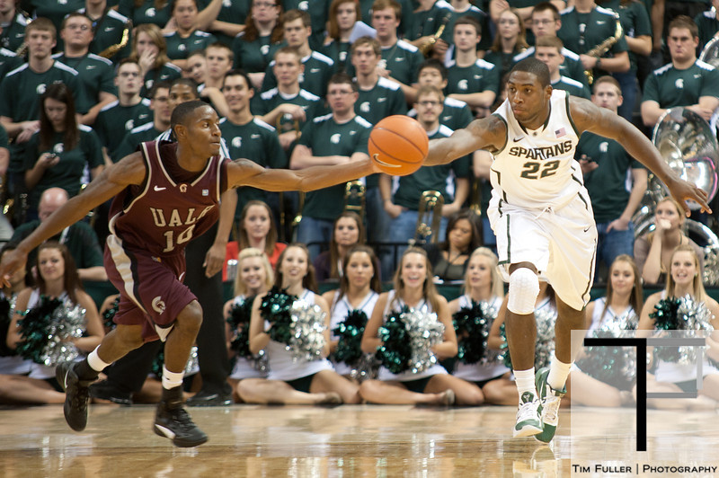 Nov 20, 2011; East Lansing, MI, USA; Arkansas Little Rock Trojans guard D'Andre Williams (10) and Michigan State Spartans forward Branden Dawson (22) battle for a loose ball during the first half at the Breslin Center. Mandatory Credit: Tim Fuller-US PRESSWIRE
