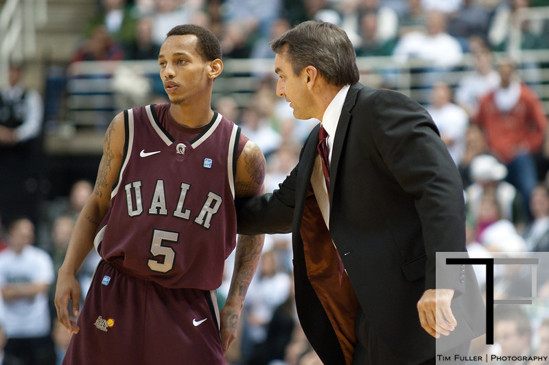 Nov 20, 2011; East Lansing, MI, USA; Arkansas Little Rock Trojans head coach Steve Shields (right) talks to Arkansas Little Rock Trojans guard Eric Lawton (5) during the second half against the Michigan State Spartans at the Breslin Center. The Spartans won 69-47. Mandatory Credit: Tim Fuller-US PRESSWIRE