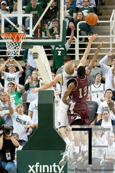 Nov 20, 2011; East Lansing, MI, USA;  Michigan State Spartans guard Austin Thornton (13) and Arkansas Little Rock Trojans guard Chuck Guy (13) go for a rebound during the second half at the Breslin Center. The Spartans won 69-47. Mandatory Credit: Tim Fuller-US PRESSWIRE