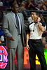 Jan 12, 2013; Auburn Hills, MI, USA; Utah Jazz head coach Tyrone Corbin (left) talks to referee Marat Kogut (right) during the game against the Detroit Pistons at The Palace. Jazz won 90-87. Mandatory Credit: Tim Fuller-USA TODAY Sports