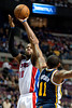 Jan 12, 2013; Auburn Hills, MI, USA; Detroit Pistons center Greg Monroe (10) shoots over Utah Jazz point guard Earl Watson (11) during the first quarter at The Palace. Mandatory Credit: Tim Fuller-USA TODAY Sports