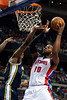 Jan 12, 2013; Auburn Hills, MI, USA; Detroit Pistons center Greg Monroe (10) goes to the basket against the Utah Jazz during the first quarter at The Palace. Mandatory Credit: Tim Fuller-USA TODAY Sports