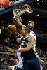 Jan 12, 2013; Auburn Hills, MI, USA; Utah Jazz point guard Earl Watson (11) goes to the basket against Detroit Pistons center Andre Drummond (1) during the third quarter at The Palace. Jazz won 90-87. Mandatory Credit: Tim Fuller-USA TODAY Sports