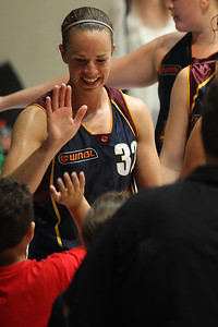 Kristen Veal thanks her young supporters - WNBL: Logan Thunder v Bendigo Spirit 12 February, 2010. The Bendigo Spirit were down most of the the game, but ended up with the win, 86-82.