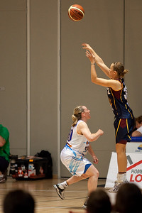 Ktisten Veal shoots over Kristi Harrower - WNBL: Logan Thunder v Bendigo Spirit 12 February, 2010. The Bendigo Spirit were down most of the the game, but ended up with the win, 86-82.