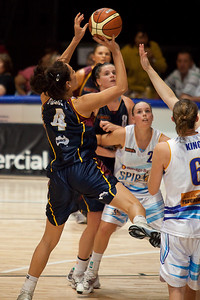 An off-balance Natalie Purcell goes to the hoop as Kelly Wilson boxes-out - WNBL: Logan Thunder v Bendigo Spirit 12 February, 2010. The Bendigo Spirit were down most of the the game, but ended up with the win, 86-82.