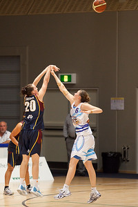 Rebecca Haynes shoots over Lauren Kiing - WNBL: Logan Thunder v Bendigo Spirit 12 February, 2010. The Bendigo Spirit were down most of the the game, but ended up with the win, 86-82.