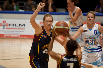 Marta Dydek raises her fist to indicate she's setting a screen for team-mate Megan Michael - WNBL: Logan Thunder v Bendigo Spirit 12 February, 2010. The Bendigo Spirit were down most of the the game, but ended up with the win, 86-82.