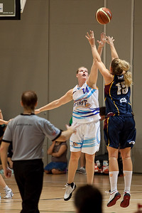Marta Dydek shoots over Chelsea Aubry - WNBL: Logan Thunder v Bendigo Spirit 12 February, 2010. The Bendigo Spirit were down most of the the game, but ended up with the win, 86-82.