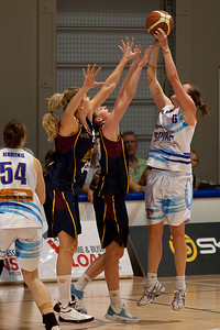 Lauren King shoots over Rebecca Haynes & Marta Dydek - WNBL: Logan Thunder v Bendigo Spirit 12 February, 2010. The Bendigo Spirit were down most of the the game, but ended up with the win, 86-82.