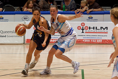 Natalie Purcell is guarded closely by Lauren King - WNBL: Logan Thunder v Bendigo Spirit 12 February, 2010. The Bendigo Spirit were down most of the the game, but ended up with the win, 86-82.