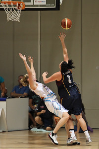 Thunder centre Holly Smith hopes to draw the foul as well as score the two points, with less than a minute left to play - WNBL: Logan Thunder v Bendigo Spirit 12 February, 2010. The Bendigo Spirit were down most of the the game, but ended up with the win, 86-82.