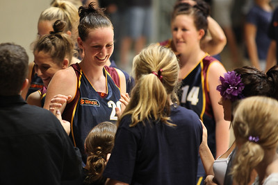 Rebecca Haynes thanks some of her army of young fans - WNBL: Logan Thunder v Bendigo Spirit 12 February, 2010. The Bendigo Spirit were down most of the the game, but ended up with the win, 86-82.