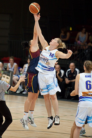Bendigo Spirit's Canadian International Chelsea Aubry jumps against Holly Smith - WNBL Logan Thunder v Bendigo Spirit 12-2-10. The Bendigo Spirit produced a come-from-behind win in the the final minutes of the game, 86-82.