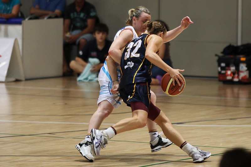 Kristi Harrower & Kristen Veal lock arms & elbows near the end of the game -  WNBL: Logan Thunder v Bendigo Spirit 12 February, 2010. The Bendigo Spirit were down most of the the game, but ended up with the win, 86-82.