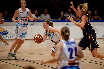 Kristi Harrower beats her taller opponent and dribbles into the key - WNBL: Logan Thunder v Bendigo Spirit 12 February, 2010. The Bendigo Spirit were down most of the the game, but ended up with the win, 86-82.