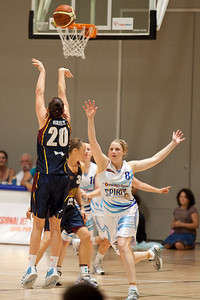 Rebecca Haynes shoots as the defence from Jasmine Finnigan arrives - WNBL: Logan Thunder v Bendigo Spirit 12 February, 2010. The Bendigo Spirit were down most of the the game, but ended up with the win, 86-82.