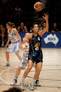Natalie Purcell catches the ball in the low post while defended by Kristi Harrower - WNBL: Logan Thunder v Bendigo Spirit 12 February, 2010. The Bendigo Spirit were down most of the the game, but ended up with the win, 86-82.