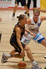 Thunder starting point guard Kristen Veal is defended by Chelsea Aubry - WNBL: Logan Thunder v Bendigo Spirit 12 February, 2010. The Bendigo Spirit were down most of the the game, but ended up with the win, 86-82.