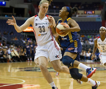 Briann January of the Indiana Fever drives past Emma Meesseman of the Washington Mystics