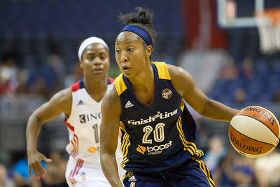 Briann January of the Indiana Fever drives past Ivory Latta of the Washington Mystics.