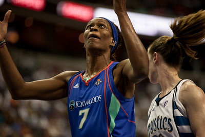 Taj McWilliams-Franklin of the New York Liberty eyes a rebound in WNBA action at the Verizon Center in Washington DC on August 20, 2010. The Washington Mystics defeated the New York Liberty 75-74 to move a win away from the Eastern Conference Regular Season Title and home court advantage in the early rounds of the playoffs. (Photo by Jeff Malet)