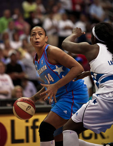 Erika Desouza of the Atlanta Dream drives on Crystal Langhorne of the Washington Mystics in WNBA action at the Verizon Center in Washington DC on August 25, 2010. The Atlanta Dream upset the top-seeded Washington Mystics 95-90 in Game 1 of their Eastern Conference semifinal. Desouza scored 12 for the Dream. Angel McCoughtry of the Dream led all scorers in the game with 28 points. (Photo by Jeff Malet)