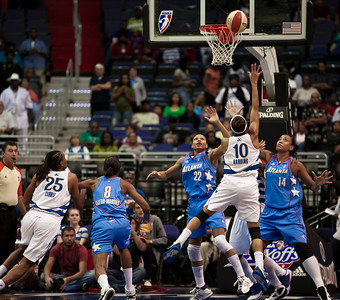 Lindsey Harding of the Washington Mystics goes up for a shot against Armintie Price and Erika Desouza of the Atlanta Dream in WNBA action at the Verizon Center in Washington DC on August 25, 2010. The Atlanta Dream upset the top-seeded Washington Mystics 95-90 in Game 1 of their Eastern Conference semifinal. Harding scored 14 points for the Mystics. Angel McCoughtry of the Dream led all scorers in the game with 28 points. (Photo by Jeff Malet)