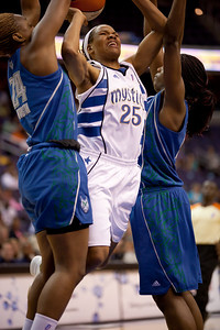 Washington Mystics forward Monique Currie goes up between Charde Houston and Nicky Anosike of the Minnesota Lynx in a WNBA match at the Verizon Center in Washington DC on August 13, 2010. The Washington Mystics defeated the Minnesota Lynx 61-58. Currie scored 4 points in the game. (Photo by Jeff Malet)