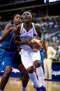 Washington Mystics Crystal Langhorne moves past Nicky Anosike of the Minnesota Lynx in a WNBA match at the Verizon Center in Washington DC on August 15, 2010. The Washington Mystics defeated the Minnesota Lynx 61-58. Langhorne scored 12 points in the game. (Photo by Jeff Malet)