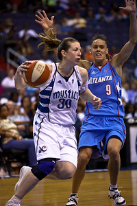 Katie Smith of the Washington Mystics drives past Coco Miller of the Atlanta Dream in WNBA action at the Verizon Center in Washington DC on August 25, 2010. The Atlanta Dream upset the top-seeded Washington Mystics 95-90 in Game 1 of their Eastern Conference semifinal. Coco Miller scored 21 in her first start of the season. Angel McCoughtry of the Dream led all scorers in the game with 28 points. Smith scored 10 points for the Mystics. (Photo by Jeff Malet)