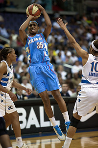 Angel McCoughtry of the Atlanta Dream goes up for a shot over Lindsey Harding of the Washington Mystics in WNBA action at the Verizon Center in Washington DC on August 25, 2010. The Atlanta Dream upset the top-seeded Washington Mystics 95-90 in Game 1 of their Eastern Conference semifinal. Angel McCoughtry of the Dream led all scorers in the game with 28 points.(Photo by Jeff Malet)