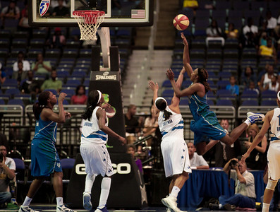 Minnesota Lynx' Rebekkah Brunson shoots over Marissa Coleman of the Washington Mystics  in a WNBA match at the Verizon Center in Washington DC on August 13, 2010. The Washington Mystics defeated the Minnesota Lynx 61-58. (Photo by Jeff Malet)
