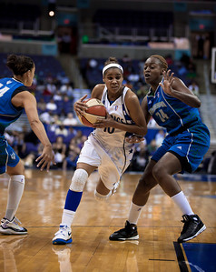 Washington Mystics Lindsey Harding drives past Charde Houston of the Minnesota Lynx in a WNBA match at the Verizon Center in Washington DC on August 13, 2010. The Washington Mystics defeated the Minnesota Lynx 61-58. Harding led all scorers with 15 points in the game. (Photo by Jeff Malet)