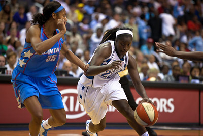 Matee Ajavon of the Washington Mystics drives past Angel McCoughtry of the Atlanta Dream  in WNBA action at the Verizon Center in Washington DC on August 25, 2010. The Atlanta Dream upset the top-seeded Washington Mystics 95-90 in Game 1 of their Eastern Conference semifinal. Angel McCoughtry of the Dream led all scorers in the game with 28 points. Ajavon scored 16 for the Mystics. (Photo by Jeff Malet)