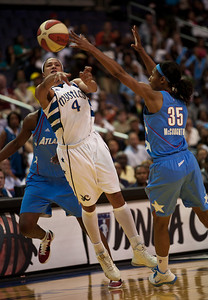Marissa Coleman of the Washington Mystics is blocked by Angel McCoughtry of the Atlanta Dream in WNBA action at the Verizon Center in Washington DC on August 25, 2010. The Atlanta Dream upset the top-seeded Washington Mystics 95-90 in Game 1 of their Eastern Conference semifinal. Angel McCoughtry led all scorers with 28 points. (Photo by Jeff Malet)