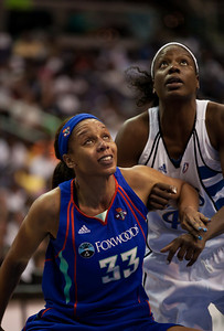 Plenette Pierson of the New York Liberty and Nakia Sanford vie for a rebound in WNBA action at the Verizon Center in Washington DC on August 20, 2010. The Washington Mystics defeated the New York Liberty 75-74 to move a win away from the Eastern Conference Regular Season Title and home court advantage in the early rounds of the playoffs. (Photo by Jeff Malet)