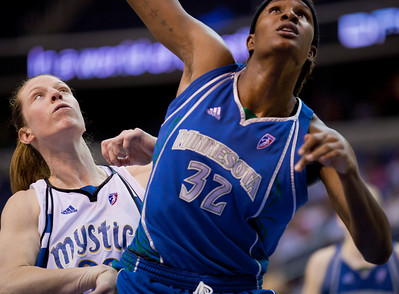 Rebekkah Brunson of the Minnesota Lynx goes up against Katie Smith of the Washington Mystics in a WNBA match at the Verizon Center in Washington DC on August 13, 2010. The Washington Mystics defeated the Minnesota Lynx 61-58. (Photo by Jeff Malet)
