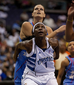 "Crystal Langhorne of the Washington Mystics fronts 6'7"" Alison Bales of the Atlanta Dream in WNBA action at the Verizon Center in Washington DC on August 25, 2010. The Atlanta Dream upset the top-seeded Washington Mystics 95-90 in Game 1 of their Eastern Conference semifinal. Angel McCoughtry of the Dream led all scorers in the game with 28 points. Langhorne scored 16 for the Mystics. (Photo by Jeff Malet)"