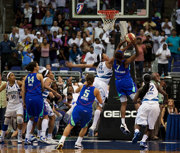 In the final seconds of the game and behind by one point,Taj McWilliams-Franklin of the New York Liberty grabs an offensive rebound against Marissa Coleman of the Washington Mystics. The Liberty would fail to score in WNBA action at the Verizon Center in Washington DC on August 20, 2010. The Washington Mystics defeated the New York Liberty 75-74 to move a win away from the Eastern Conference Regular Season Title and home court advantage in the early rounds of the playoffs. (Photo by Jeff Malet)